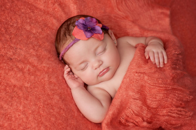 Sleeping Baby Girl on Orange Blanket