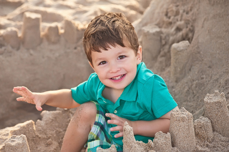 Happy Boy Building a Sandcastle