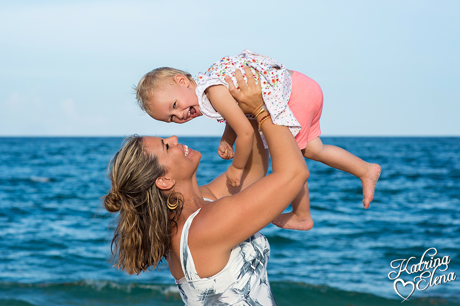 Mother & Daughter Playing on Beach