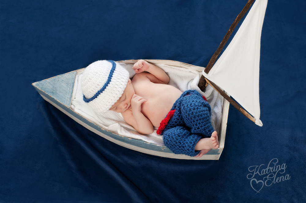 Newborn Sailor in Sailboat