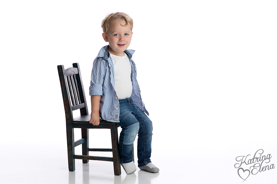 Smiling Boy Sitting on Child's Chair