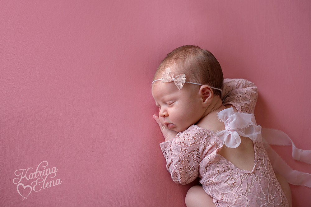 Baby Girl in Pink Lace Romper