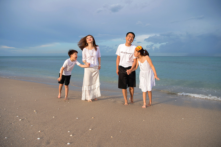 A funny and casual family portrait on the beach. A travel photoshoot while the family was on vacation in Singer Island, FL.